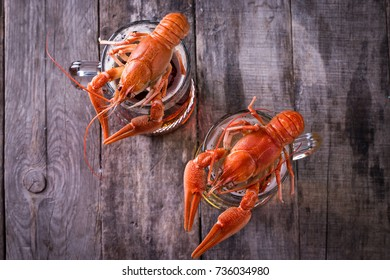 beer on a dark background. Nearby boiled crayfishes Snack to beer. party atmosphere