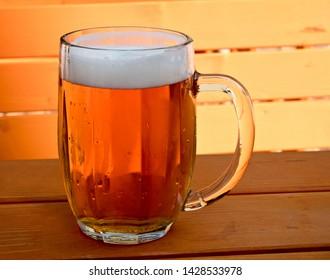 Beer on the desk in a garden restaurant