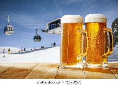 beer on desk and winter landscape of snow