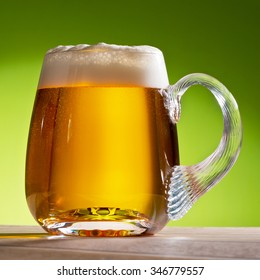 beer on the table with green background
