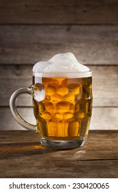 Beer on a wooden background with copy space