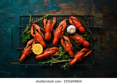 Beer party. Still life with crayfish crawfish on old wooden rustic background. Seafood. Top view. Flat lay.