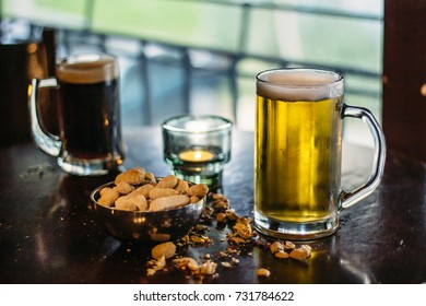 Beer and peanuts in rustic place.