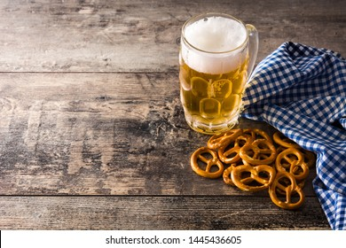 Beer with pretzels to celebrate Oktoberfest on wooden table