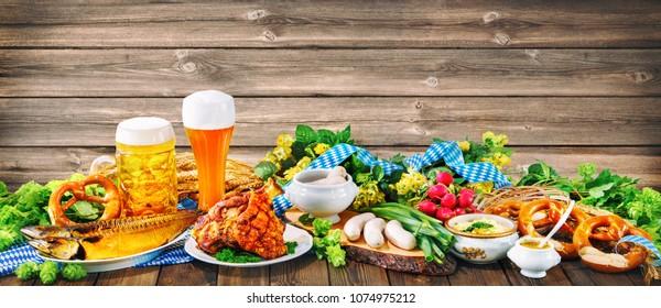 Beer, pretzels and various Bavarian specialties. Oktoberfest background