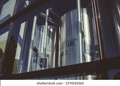 Beer processing tanks through the window of a micro brewery