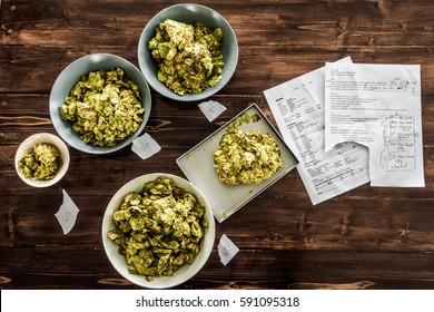 Beer Recipe and Whole Dried Hops ready to be Pitched in the Boil Kettle of a Homebrewer.