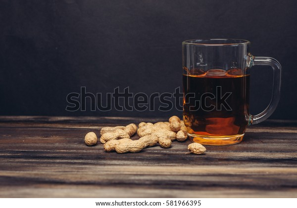 beer with roasted peanuts in shells.