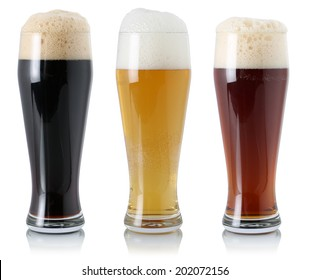 Beer set in glass with foam, isolated on a white background