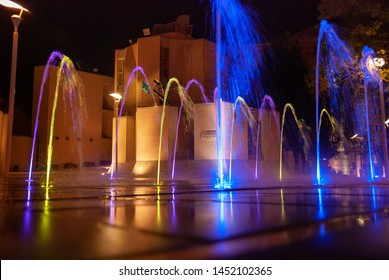 BEER SHEBA, ISRAEL - AUGUST 23, 2011: Beautiful illuminated city fountain next to city library. Night time