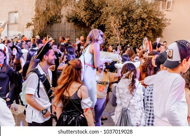BEER SHEVA, ISRAEL - MARCH 01, 2018: Purim carnival on the street in Beer-Sheva. Happy purim day in Israel. People wearing costumes for traditional funny celebration of jewish holiday.