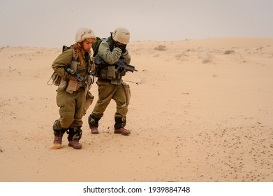 Beer Sheva, Israel - March 20, 2013 : An Israeli women soldiers in the IDF women and men combined unit marching during training.