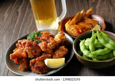Beer and side dishes (karaage,grilled chicken wings,edamame)