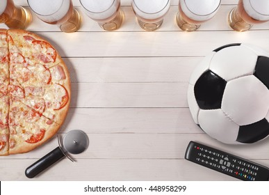 Beer and Soccer / Footbal. glasses of beer with pizza and soccer ball. Copy space.