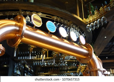 beer tap pours draught lager beer serving in a restaurant or pub