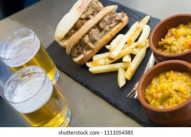 Beer and tapas, paella and beef sandwich in granada, spain
