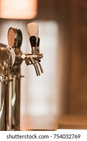 Beer taps at bar counter at the restaurant