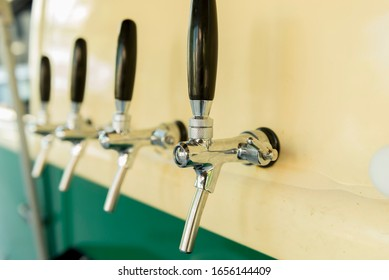 The beer taps in a side of a vintage van. nobody. Selective focus. Alcohol concept. Vintage style. Beer craft.
