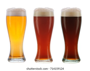 Beer: Three different beers in identical glasses with foamy tops and condensation.
