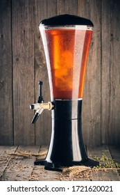 Beer tower with hop, malt and wheat on wood background