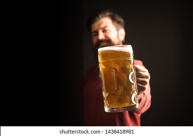 Beer in the UK. Happy brewer holding glass with beer. Brewer. Beer in the US. Germany - Bavaria. Barman. Man with beer