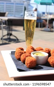 Beer and warm fried snacks, dutch bitterballen: stuffed fried meatballs