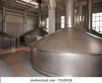 Beer-making tanks in large industrial building