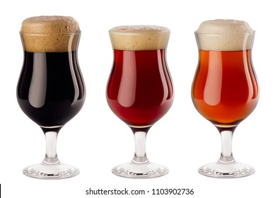 Beers collection poured in wineglasses with foam - lager, red ale, porter -  isolated on white background.