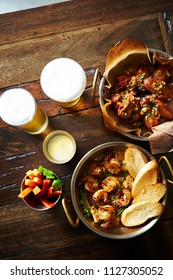 Beers with garlic shrimp and fried chicken