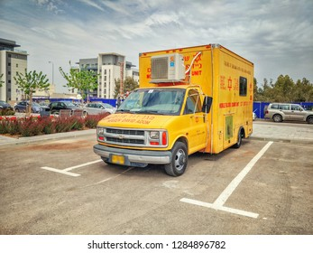 Beersheba, Israel-March 28, 2018: Mobile blood donor unit in a yellow van equipped with two couches for two donors and necessary equipment for blood storage. It stands on a parking lot.