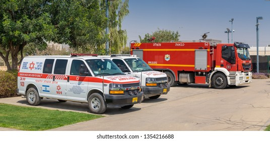"BEER-SHEVA, ISRAEL - MARCH 21, 2019: Israeli ambulance cars, called ""Magen David Adom"" and firetruck"