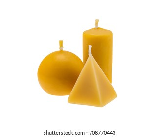 Beeswax candles isolated over white