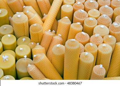 beeswax candles in yellow and orange