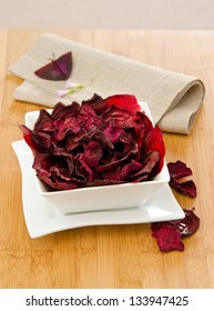 beet chips in a white bowl