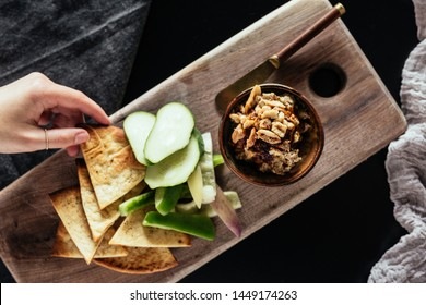 Beet Eggplant Hummus with Pita Chips and Cucumber Slices