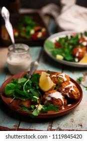 Beet falafel with tahina  sauce and green . salad selective focus