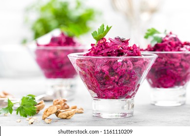 Beet salad. Salad of boiled beet. Beetroot salad with prune, walnuts and sour cream on white background