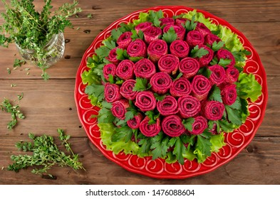 Beet salad with pancakes in the shape of a bouquet of roses. Decoration is made of pancakes