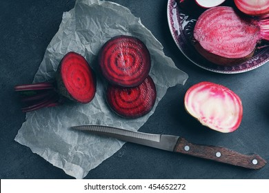 Beet slices on grey table