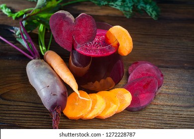 beet-Carrot juice in glass on wooden table