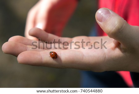Black dots on hands and fingers