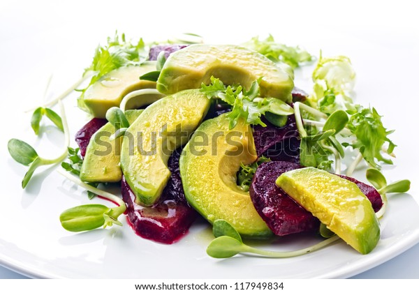 Beetroot and avocado salad with lemon and Fresh sunflower sprouts Lenten meal