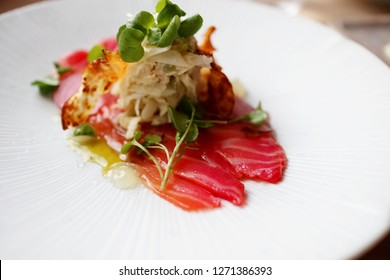 Beetroot and Davidson Plum Cured Salmon with Green Apple and Celeriac Slaw and Coriander Oil