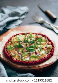 beetroot pizza crust with fresh swiss chard or mangold, beetroot leaves. Ideas and recipes for vegan snack.Egg-free pizza crust with chia seeds and wholegrain brown rice flour. Copy space. Shallow DOF