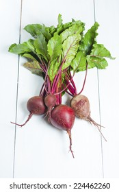 beetroot plants on white wood table