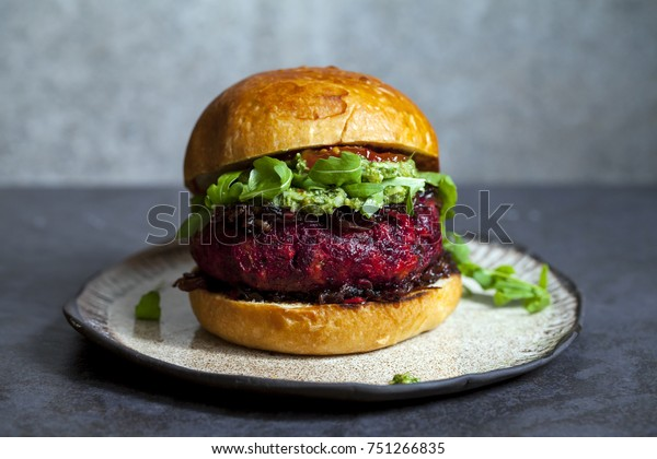 Beetroot and red beans burger in the brioche bun