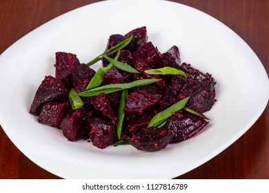 Beetroot salad with onion in the plate