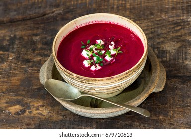 Beetroot soup garnished with feta cheese and fresh thyme