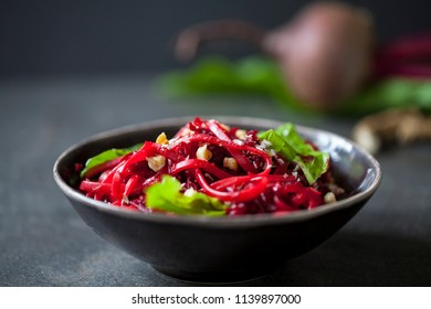Beetroot spaghetti with hazelnuts and horseradish