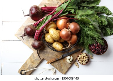 Beets, potatoes, onions, dill, garlic, red beans and cashews on the table